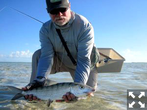 Capt. Rick Grassett with a South Andros bonefish caught and released on a fly while fishing out of Mars Bay Bonefish Lodge.