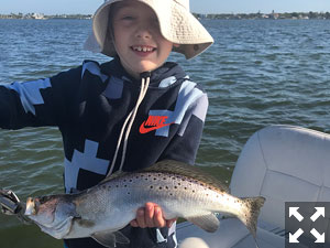 Eight year old Collin hooked and reeled in this larger trout.