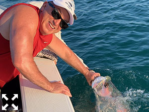 David Miller with a Tarpon he battled, caught, and released.