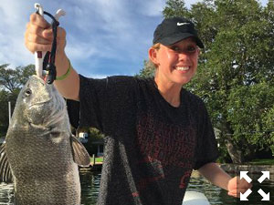 Emma Vincent with a nice black drum, and her brother John with a nice redfish.