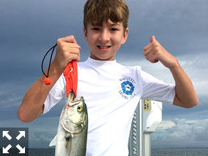 10 yr old Lawson Pressley of South Carolina with a nice bluefish he caught on a shrimp.