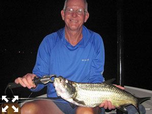 Bob Delano, from GA, with a juvenile tarpon he caught on a different trip with Capt. Rick Grassett in a previous August.